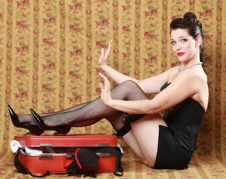 Feminine Pin Up Girl in Studio With Luggage photo
