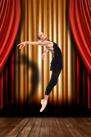 Female Ballet Dancer on Stage With Drapes photo