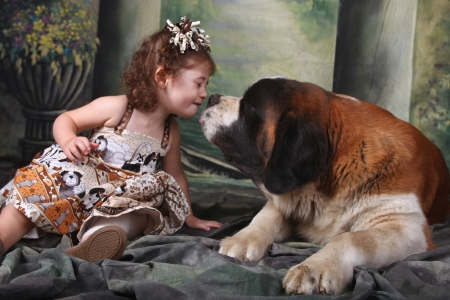 Child and Her Saint Bernard Puppy Dog Stock Photo - 15154295