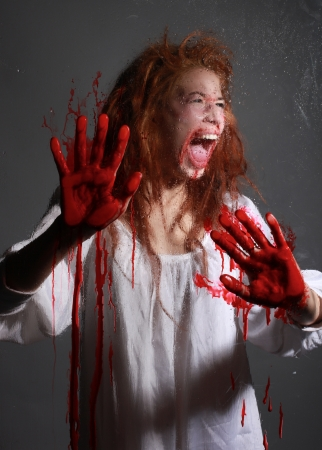 Woman in Horror Situation With Bloody Face Stock Photo - 15154301