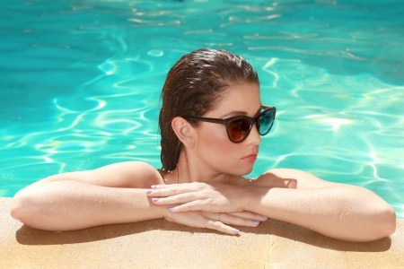 Beautiful Woman With a Swimming Pool During Summer photo
