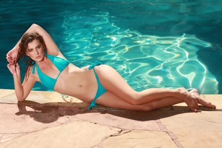 sun bathing: Beautiful Woman With a Swimming Pool During Summer Stock Photo