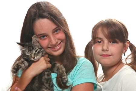 Sisters Holding Their Young Kitten on White Stock Photo - 15154297