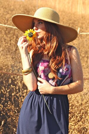 Beautiful Woman in a Field During Summer With Hat Stock Photo - 15154314