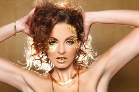 Stunning Female Model Adorned with Gold Leaf Cosmetics Stock Photo - 16796698