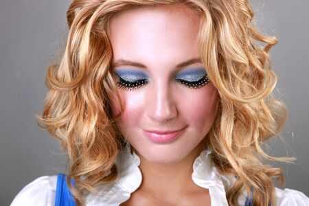 Beautiful Makeup on a Blonde Woman Looking Down Stock Photo - 16796697