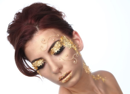 Stunning Female Model Adorned with Gold Leaf Cosmetics Stock Photo - 16796704