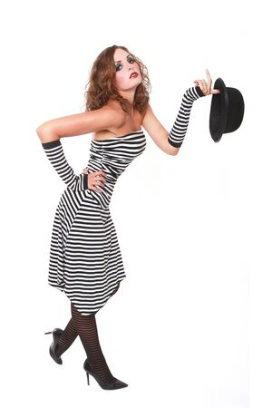 High Fashion Model in Striped Holding Hat Stock Photo - 16796703