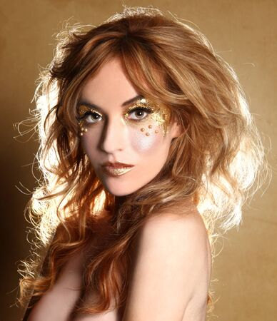 Stunning Female Model Adorned with Gold Leaf Cosmetics Stock Photo - 16796707