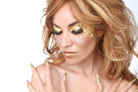 Stunning Female Model Adorned with Gold Leaf Cosmetics Stock Photo - 16796717