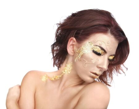 Stunning Female Model Adorned with Gold Leaf Cosmetics Stock Photo - 16796708