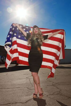 Beautiful Woman Holding American Flag Outdoors Stock Photo - 16796709