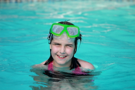 Young Girl Child in a Swimming Pool Stock Photo - 16796700