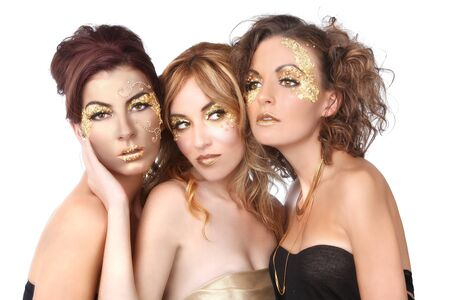 Stunning Female Models Adorned with Gold Leaf Cosmetics Stock Photo - 16796711