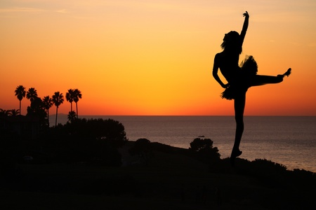 Silhouette of a Ballet Dancer at Sunset Outdoors Stock Photo - 17499602