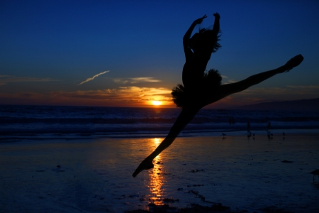 leap: Silhouette of a Ballet Dancer at Sunset Outdoors