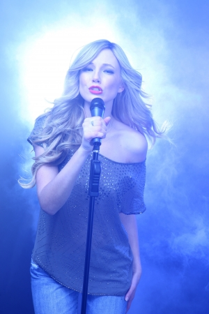 Blonde Rock Star on Stage Singing and Performing Stock Photo - 17457791