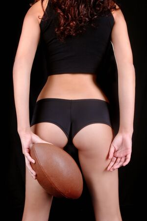 Sexy Young Woman With a Football Stock Photo - 17499603
