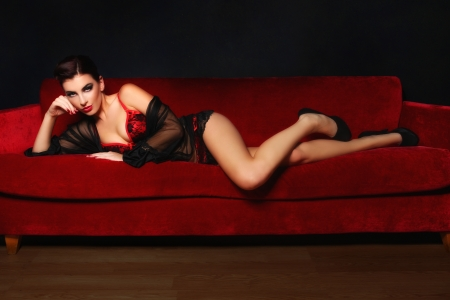 Studio Photo of a Sexy Woman on a Couch Stock Photo - 17457835