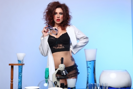 Exaggerated Science Student in Sexy Clothing Experimenting Stock Photo - 17480797