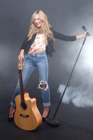 Blonde Rock Star on Stage Singing and Performing Stock Photo - 17457788