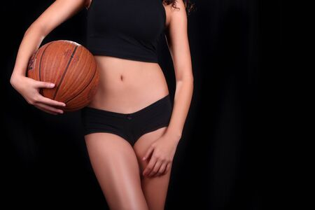 Fit Young Woman Holding a Basketball Stock Photo - 17499594