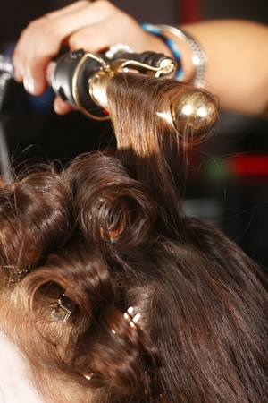 Hairstylist Curling Hair in a Salon Stock Photo - 17921013