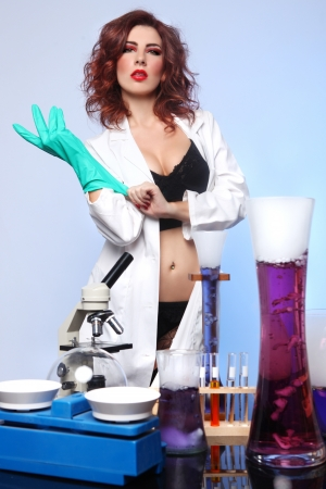 exaggerated: Exaggerated Science Student in Sexy Clothing Experimenting
