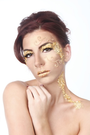 Stunning Female Model Adorned with Gold Leaf Cosmetics Stock Photo - 17827520