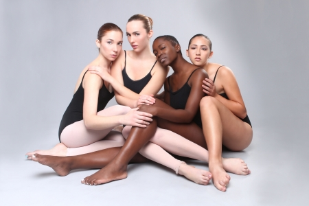 Group of 4 Women Posing on Neutral Background Stock Photo - 18349063