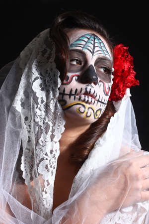 painting face: Face Painted for Day of the Dead on a Woman Stock Photo
