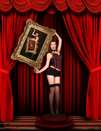 Sexy Circus Pinup Model on Red Draped Stage