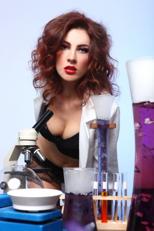 Exaggerated Science Student in Sexy Clothing Experimenting Stock Photo - 18349038