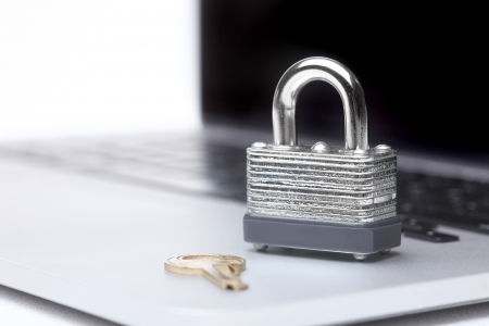 Laptop Computer With Lock and Key Symbolizing Protection and Safety Stock Photo - 19485769