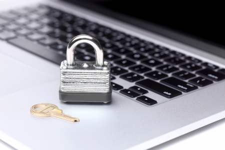 Laptop Computer With Lock and Key Symbolizing Protection and Safety Stock Photo - 19485796