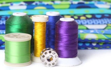 Sewing and Quilting Thread With Fabric and Copy Space photo