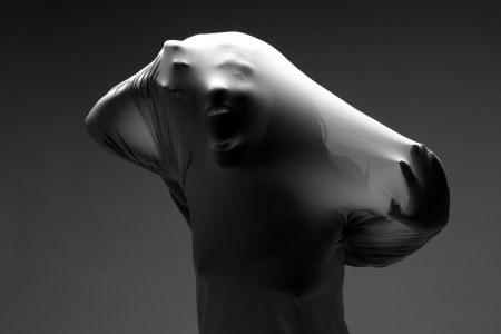 abhorrence: Horror Image of a Woman Trapped in Fabric