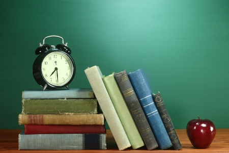 new school: Back to School Books, Apple and Clock on Desk Stock Photo