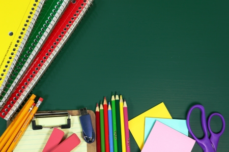 returning: Miscellaneous Back to School Items on a Chalkboard Background