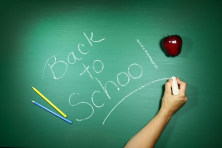 returning: Message of Back to School Written on a Chalkboard