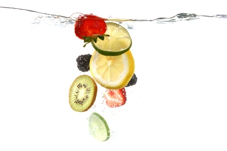 falling water: Sliced Fruits Falling Into Splashing Clear Water