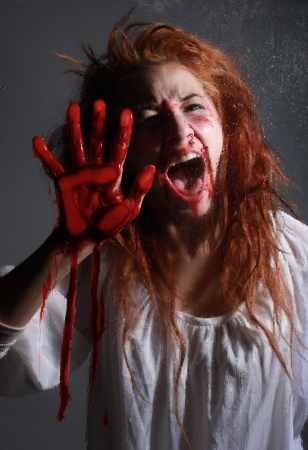 Woman in Horror Situation With Bloody Face photo