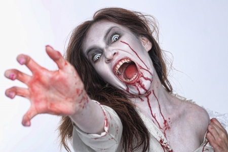 woman shouting: Bleeding Psychotic Woman in a Horror Themed Image Stock Photo