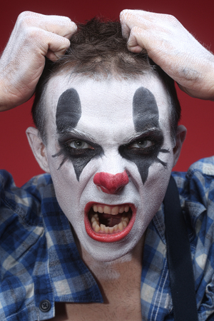 Evil Spooky Clown Portrait on Red photo