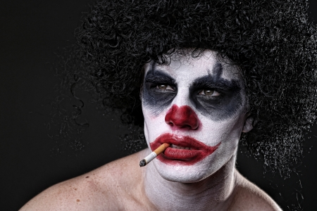 Evil Spooky Clown Portrait on Black  Stock Photo