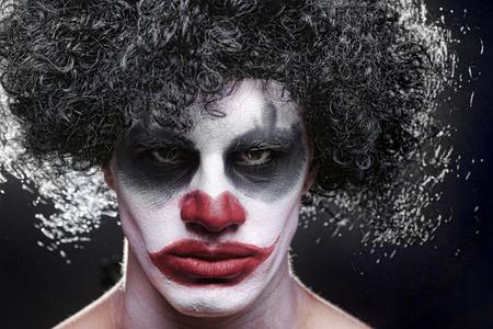 Evil Spooky Clown Portrait on Black  photo