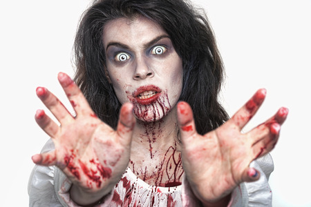 fear face: Bleeding Psychotic Woman in a Horror Themed Image Stock Photo