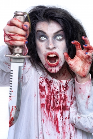 Scary Horror Image of a Bleeding Psychotic Woman With Knife photo