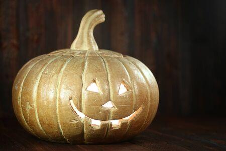 Pumpkin Jack O Lantern on Wood Grunge Rustick  Фото со стока