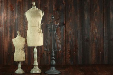 wooden mannequin: Vintage Antique Mannequin Busts on Wood Grunge